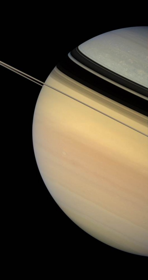 This image, taken on the same day, captures Saturn's color contrast. It is unknown why Saturn is color-patterned as it is.