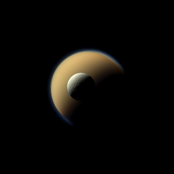Rhea (foreground) and Titan, Saturn's two largest moons, taken by Cassini probe.
